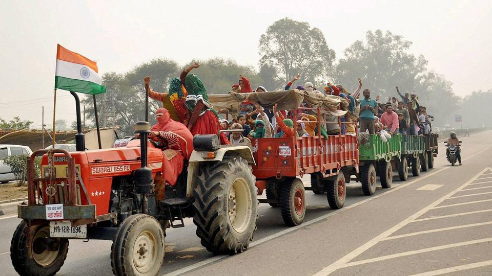 Jat women protesters are seen on a tractor  at Jassia village as they demand reservation, in Rohtak . The agitation for quota reservation by Jats, which was confined to Haryana so far, has started spreading to parts of Delhi. (PTI)