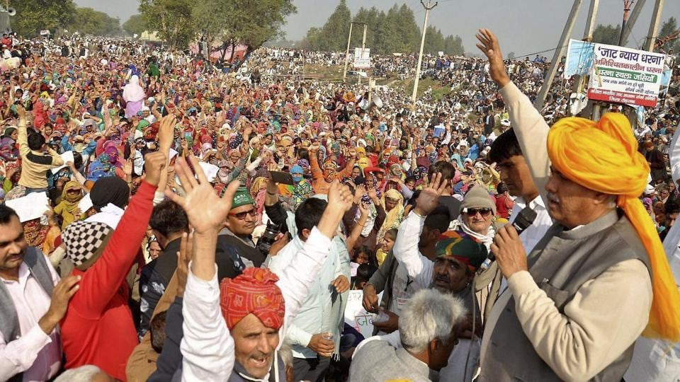 AIJASS national president Yashpal Malik speaks  during the Jat protest at Jassia village in Rohtak. (PTI Photo)