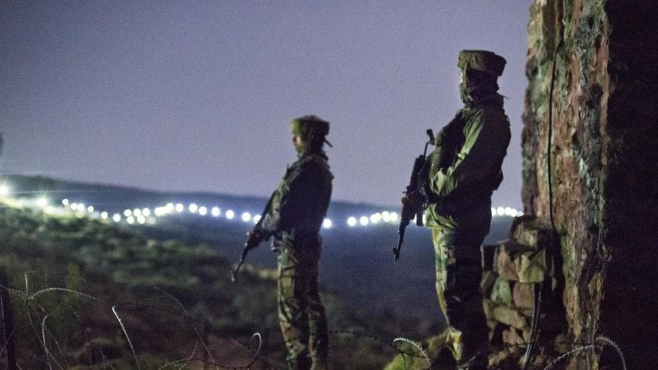 Indian Army soldiers at forward posts beyond the illuminated fence in Hamirpur area near Bhimber Gali, about 180 km north west of Jammu, September 2015.