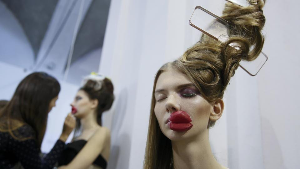 A model waits backstage for her turn to walk the ramp at the Ukrainian Fashion Week in Kiev on February 7.  (Reuters)