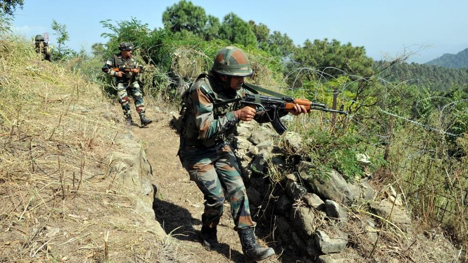 Soldiers in position near the Line of Control in Nowshera sector, Jammu and Kashmir, following repeated ceasefire violations since September 2016.