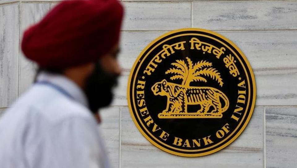 People walk past the Reserve Bank of India (RBI) head office in Mumbai.