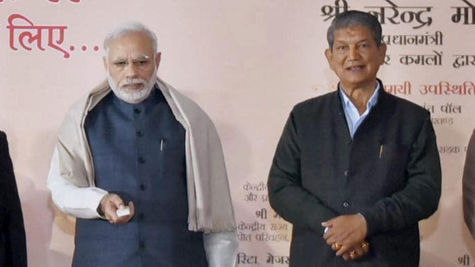 Prime Minister Narendra Modi with Uttarakhand CM HarishRawat at the Char Dham Rajmarg Vikas Pariyojna in Dehradun.