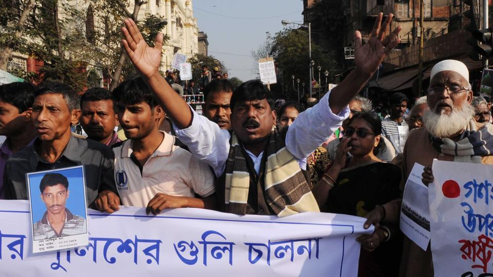 Sukur Ali Khan (extreme left), father of Mafizul Ali Khan, who was shot dead at Bhangar, walking with fellow villagers at a rally in Kolkata January 30.  The UAPA has been slapped on two leaders of CPI(ML)(Red Star), an ultra Left outfit and nine villagers, including a student set to appear for higher secondary exams.