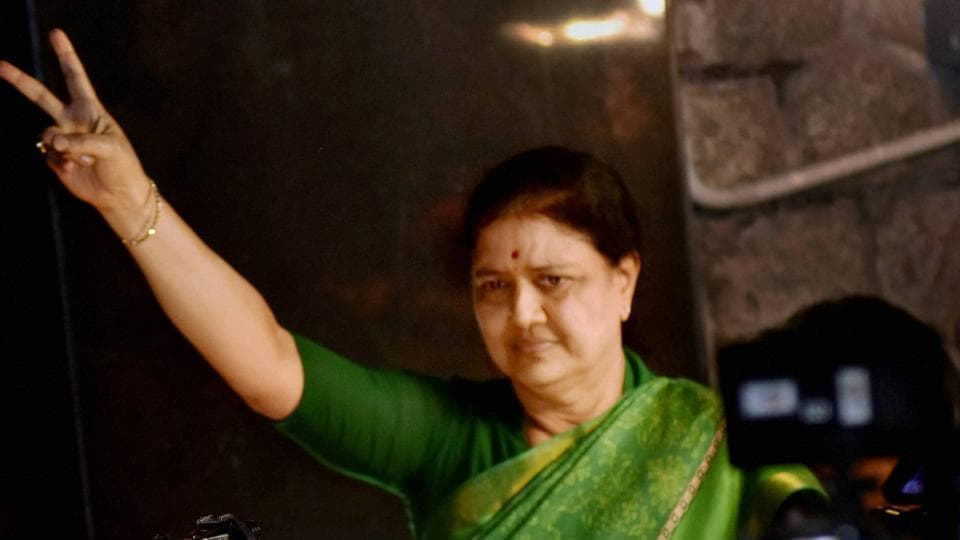 AIADMK General Secretary VK Sasikala flashes victory sign as she comes out to address media at Poes garden in Chennai late on Tuesday night.