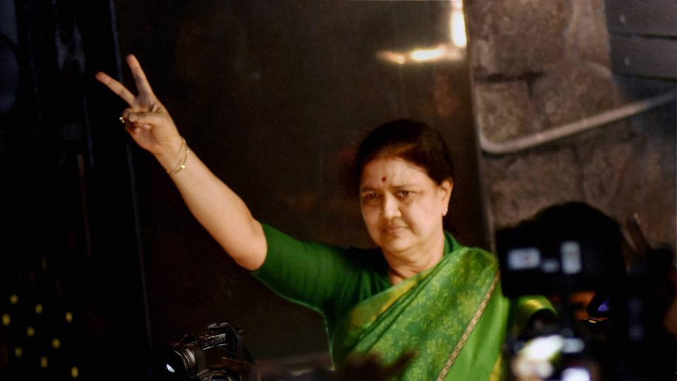 AIADMK general secretary V K Sasikala flashes victory sign as she comes out to address media at Poes garden in Chennai in the early hours on Wednesday.