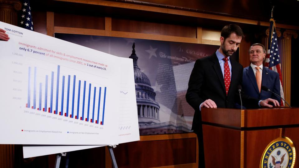 US Senator Tom Cotton (left) and Senator David Perdue unveil legislation aimed at curbing legal immigration by halving the number of legal immigrants admitted into the United States, on Tuesday.