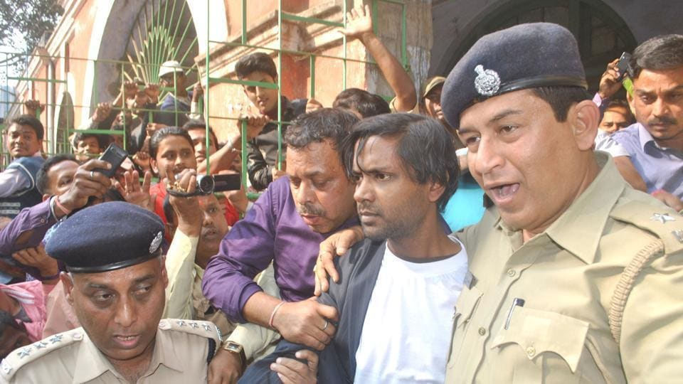 Udayan Das, accused of killing his parents and live-in partner and burying their bodies secretly, being produced in a court in Bankura in West Bengal.