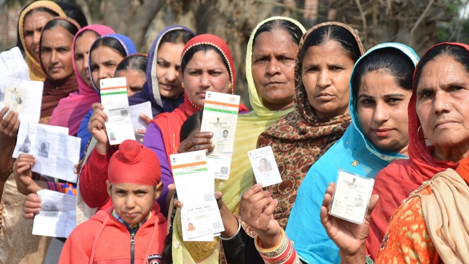 Voters showing their ID cards before casting vote during the re-polling at a polling station in Majitha constituency in Amritsar on Thursday.