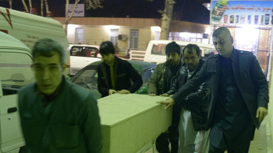 Afghan men carry a coffin of an International Committee of the Red Cross (ICRC) employee who was killed by gunmen in Jowzjan province, at a hospital in Mazar-i-Sharif, Afghanistan February 8, 2017.