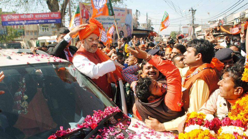 BJP national president Amit Shah is greeted by crowds during an election road show in Meerut on Friday.  The BJP is eyeing its chances in UP,  India's most populous state.  (PTI)