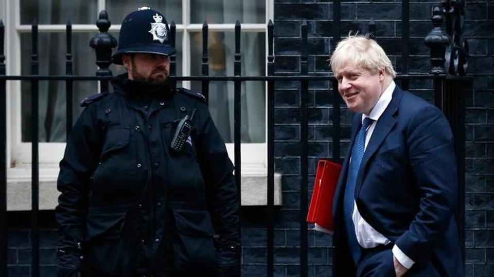 Britain's foreign secretary Boris Johnson leaves a cabinet meeting in Downing Street, London.