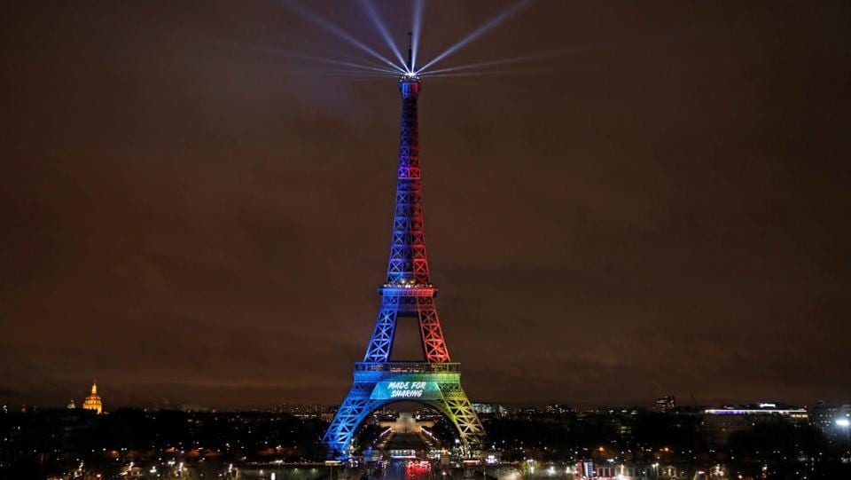 A picture shows the Eiffel Tower lit in the colours of the Olympic flag during the launch of the international campaign for the Paris bid to host the 2024 Olympic Games in Paris on February 3, 2017.