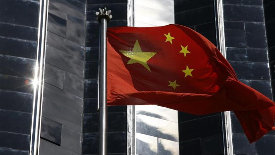 File photo of a  Chinese flag hoisted outside a commercial building in Shenzhen in southern Guangdong province.