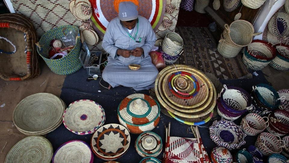 A man makes handmade ornamental products during the festival, which Saudi Arabia uses as an occasion to promote tourism.  (Faisal Al Nasser / REUTERS)