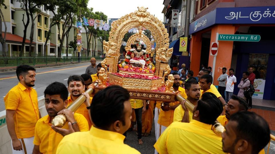 A group of men carry a palanquin with an idol of Murugan in Singapore.  Prior to Thaipusam, devotees will typically hold daily prayer sessions, abstain from sex and stick to a strict vegetarian diet for weeks. (Edgar Su / REUTERS)