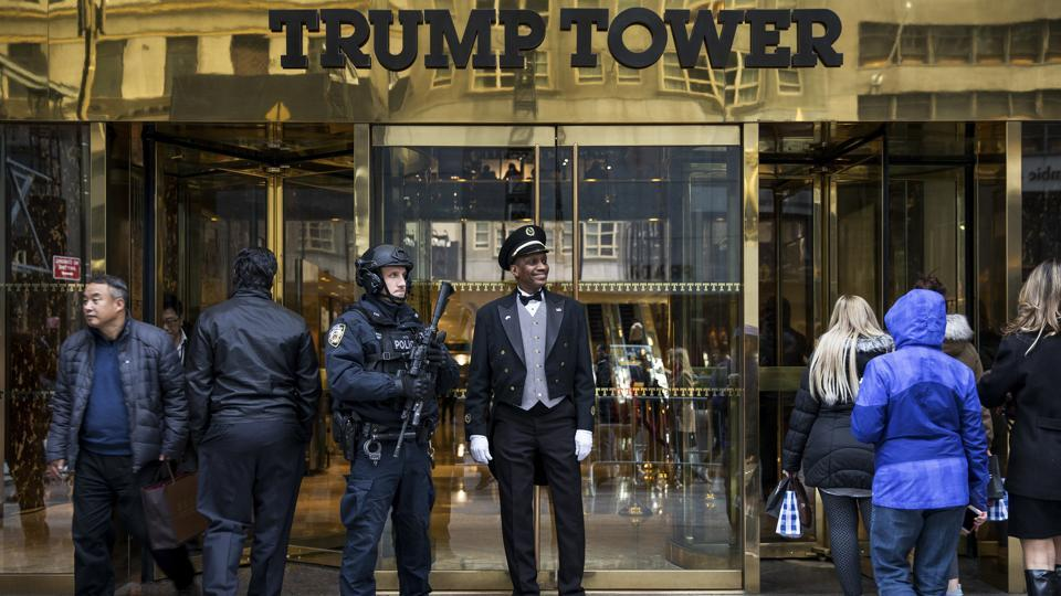 New York City police officers guard the entrance to Trump Tower on Fifth Avenue in New York.