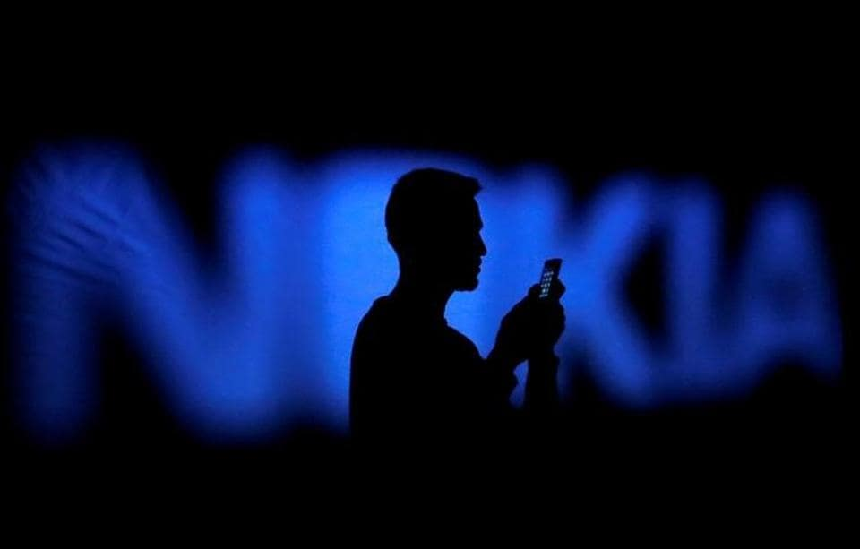 FILE PHOTO - A photo illustration of a man silhouetted against a Nokia logo in the central Bosnian town of Zenica January 23, 2014. REUTERS/Dado Ruvic/File Photo GLOBAL BUSINESS WEEK AHEAD PACKAGE - SEARCH BUSINESS WEEK AHEAD 30 JANUARY FOR ALL IMAGES