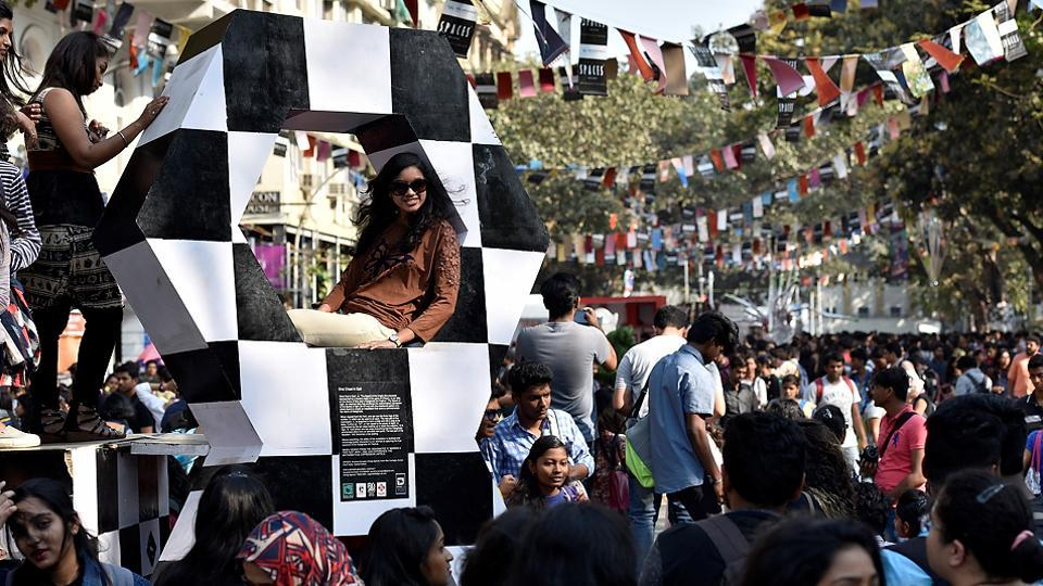 Youngsters pose on an installation at the Hindustan Times Kala Ghoda Arts Festival in Mumbai on Thursday. (Arijit Sen/HT PHOTO)