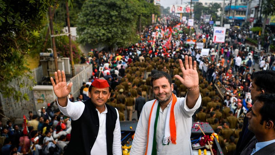 Congress party vice president Rahul Gandhi (R) and Uttar Pradesh chief minister Akhilesh Yadav (L) wave during a joint election rally in Agra . Elections in northern Uttar Pradesh begin on February 11, and voting is divided into seven phases.  (CHANDAN KHANNA / AFP)