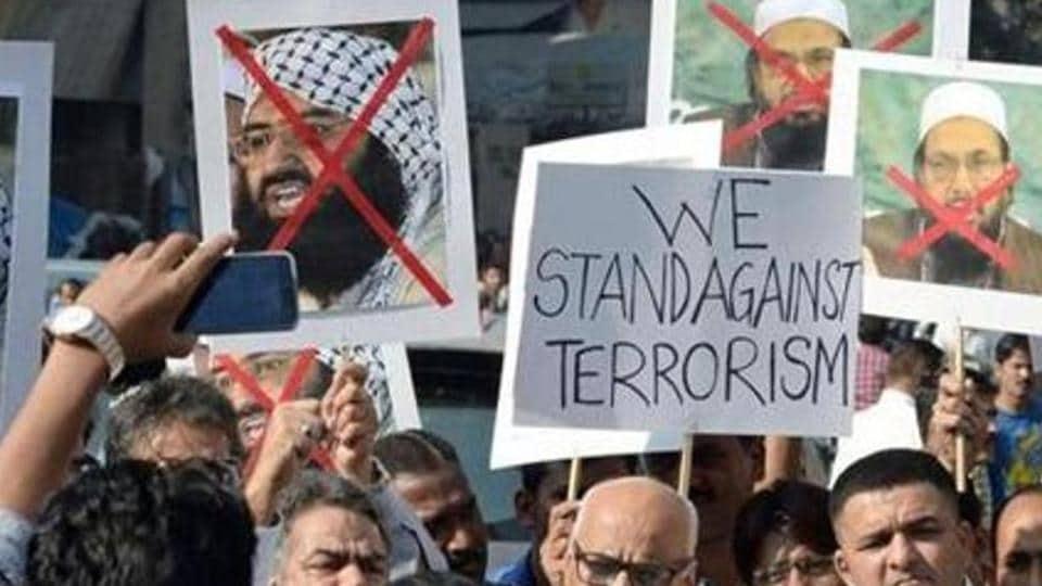 Activists protest against Maulana Masood Azhar, chief of the Jaish-e-Mohammad, and against Pakistan's outlawed Islamic hardline Jamaat ud Dawa (JD) Hafiz Mohammad Saeed in January 2016.