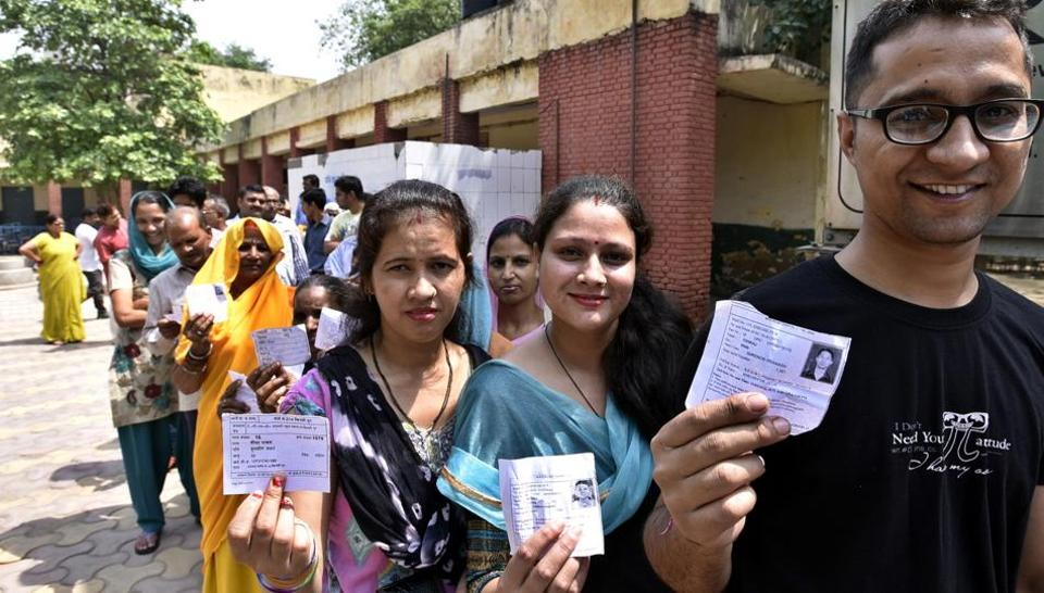 People queue up to cast their votes in the Delhi municipal bypolls at Khichripur in east Delhi in May 2016. The AAP won five seats in the bypoll.