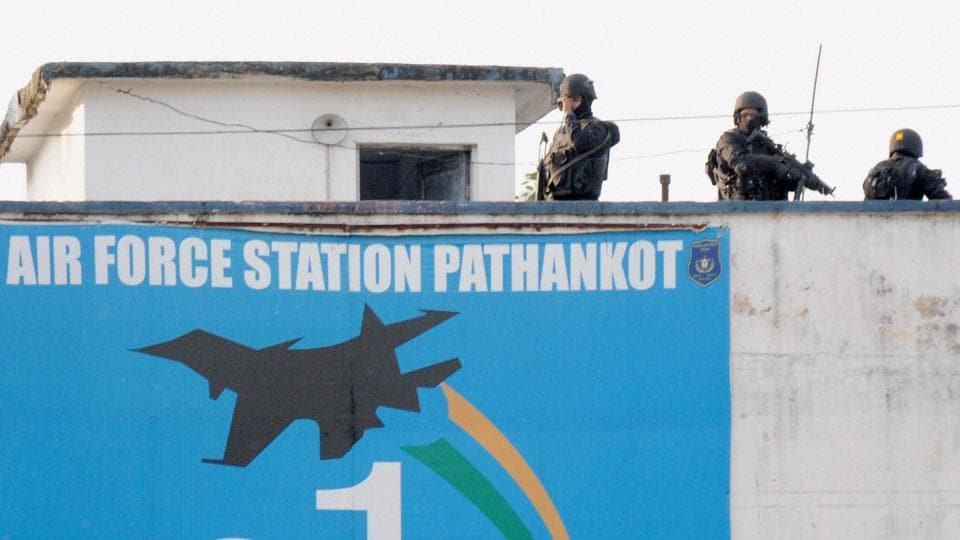 Security personnel guarding inside the Pathankot Air Force base after the end of their operation against militants on January 5, 2016.