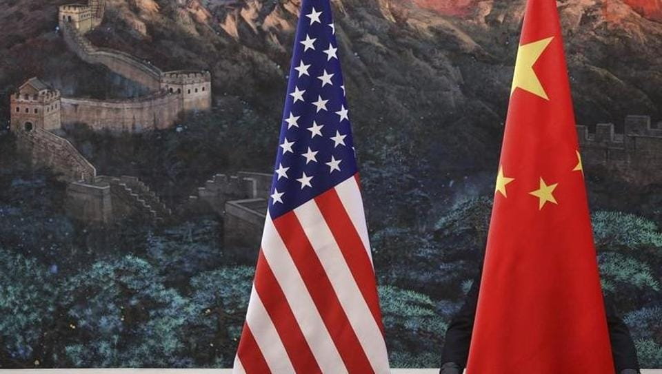 A file photo of Chinese and US flags hoisted together in Beijing.