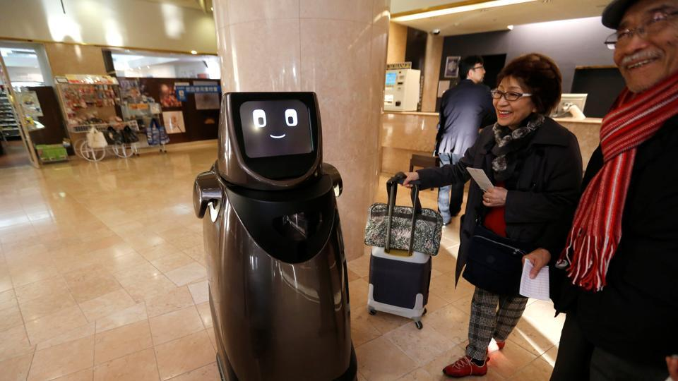 Panasonic's prototype delivery robot, HOSPI, designed to serve bottled beverages and provide bus information, is pictured at a hotel near Narita International Airport in Narita, Japan.