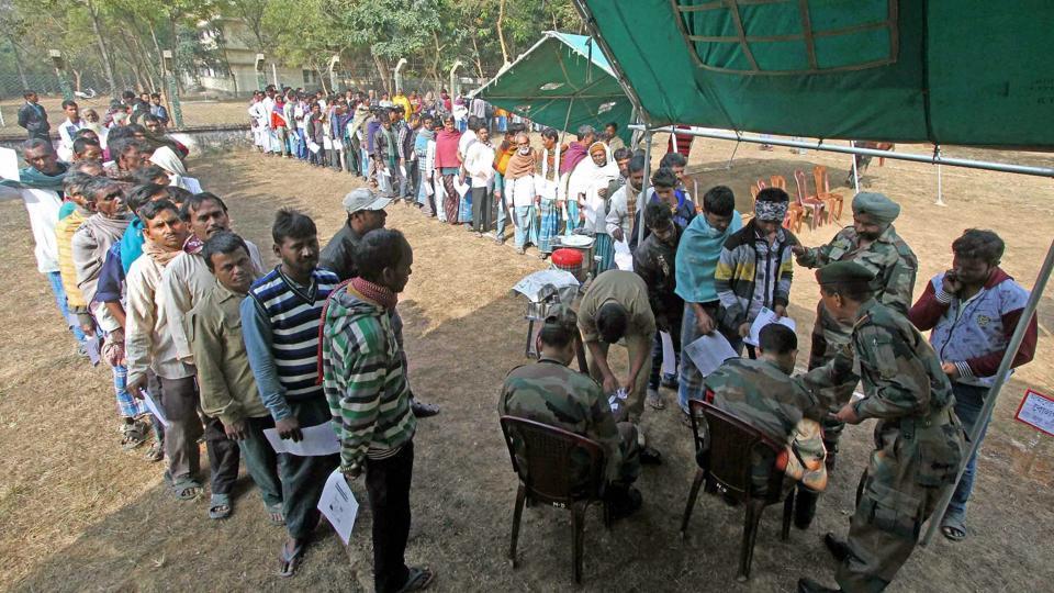People queue up to open zero balance account under the Pradhan Mantri Jan Dhan Yojana in an initiative of 50 Bengal Battalion NCC at Santiniketan in Birbhum district of West Bengal, December, 2016.