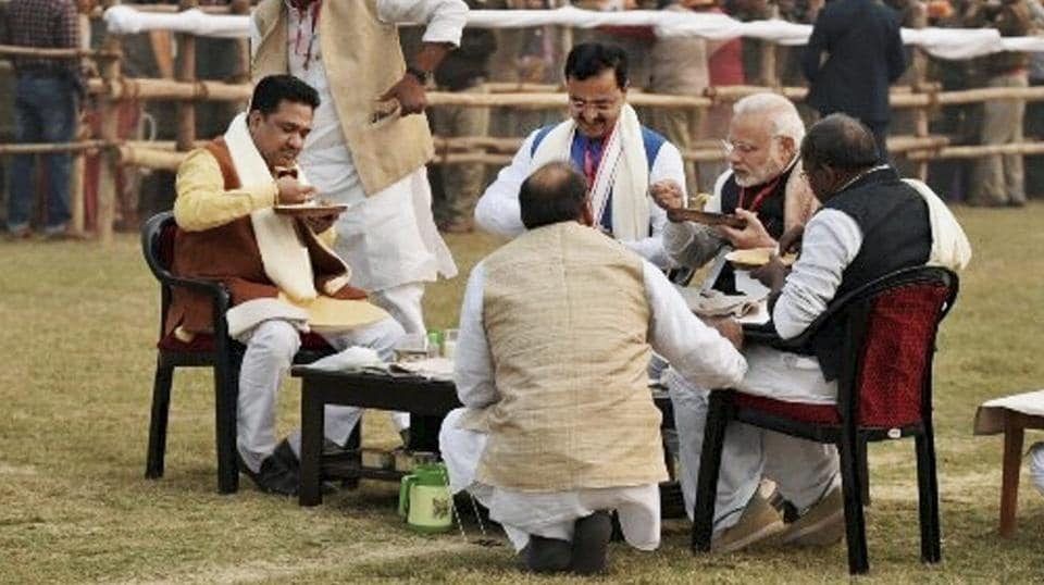 Prime Minister Narendra Modi has lunch with other BJP leaders at a meeting of party workers at DLW Ground in Varanasi . The BJP is hoping to ride on Modi's star power to attract voters.  (PTI)