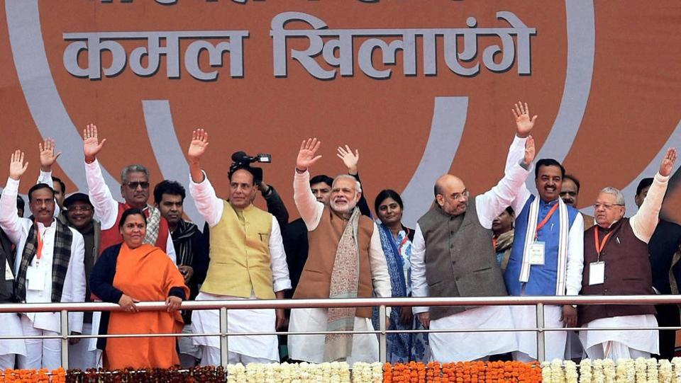 Prime Minister Narendra Modi with BJP National president Amit Shah, Rajnath Singh, Keshav Prasad Maurya and other leaders wave during the Parivartan Rally in Lucknow on Monday.  (Nand Kumar  / PTI)