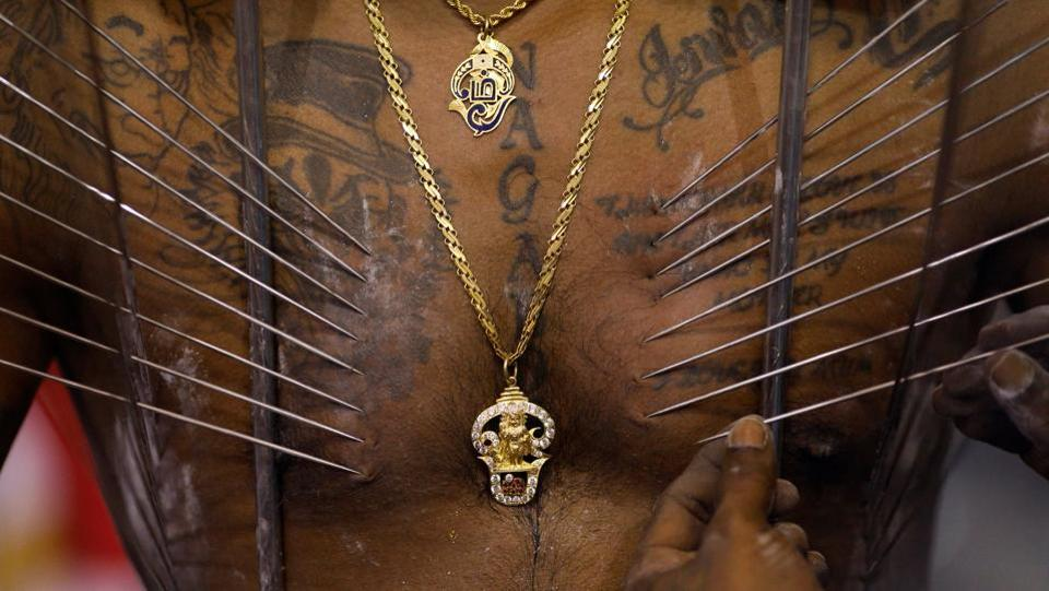 A devotee has his body pierced as he prepares to carry a kavadi during Thaipusam in Singapore. Similar to Lent and the Vegetarian Festival in Thailand, Thaipusam represents a time of self-sacrifice and penance, as gratitude for boons fulfilled. (Edgar Su / REUTERS)