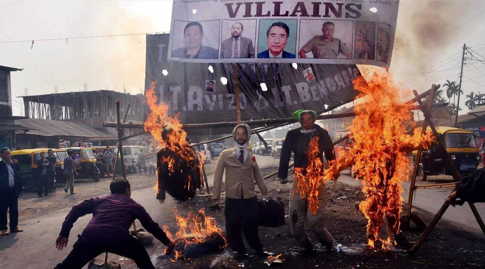 Protesters burn effigy of Nagaland chief minister TR Zeliang, home minister Y Patton, NPF President Shürhozelie and Nagaland IRB personnel during a protest against killing of two youth by security personnel last month, in Dimapur, Nagaland on Feb 7, 2017.