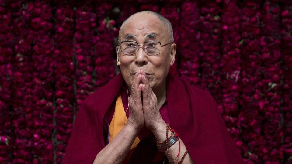 Tibetan spiritual leader the Dalai Lama gestures as he speaks on