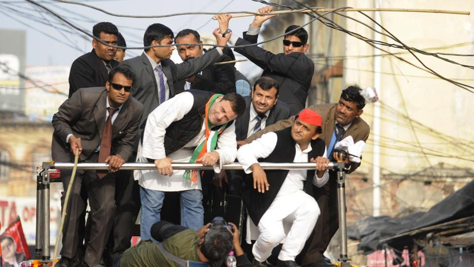 Congress vice president Rahul Gandhi and chief minister of Uttar Pradesh, Akhilesh Yadav duck under electric wires during their Lucknow, road show. The Akhilesh-Rahul alliance is one of the biggest outcomes of this election.    (Deepak Gupta   / HT photo )