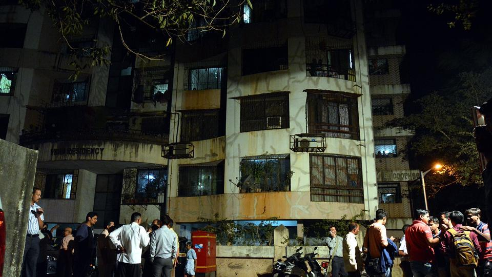 Friends and relatives standing outside the residence of the victims who passed away in an car accident at Ratnagiri.