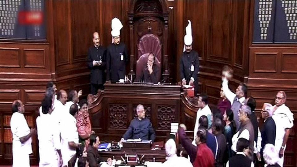 Opposition members protest in the Rajya Sabha during the Budget session of Parliament in New Delhi on Thursday. (TV GRAB)
