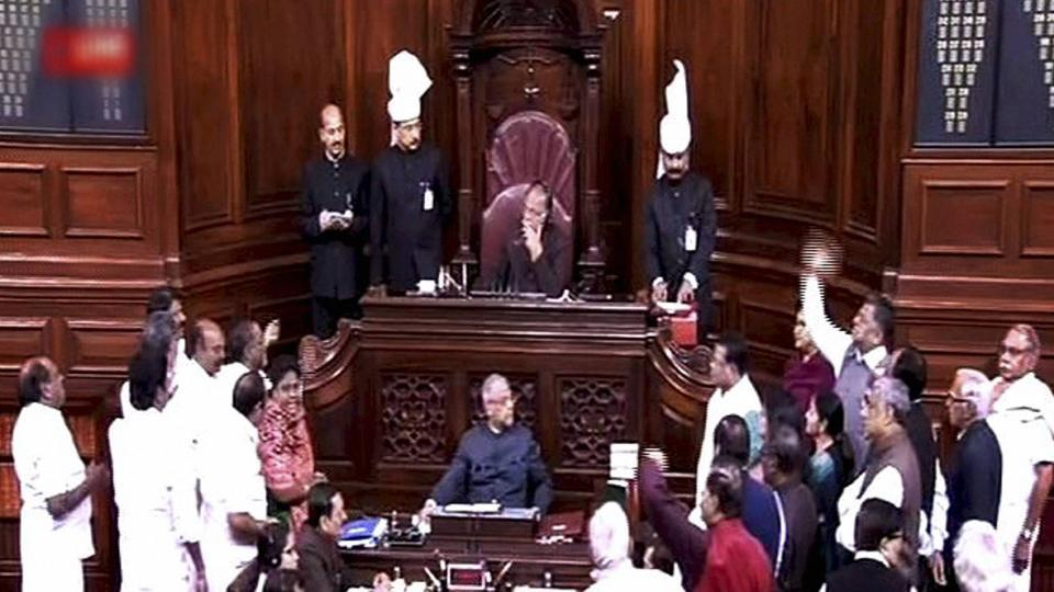 Opposition members protest in the Rajya Sabha during the Budget session of Parliament in New Delhi on Thursday.