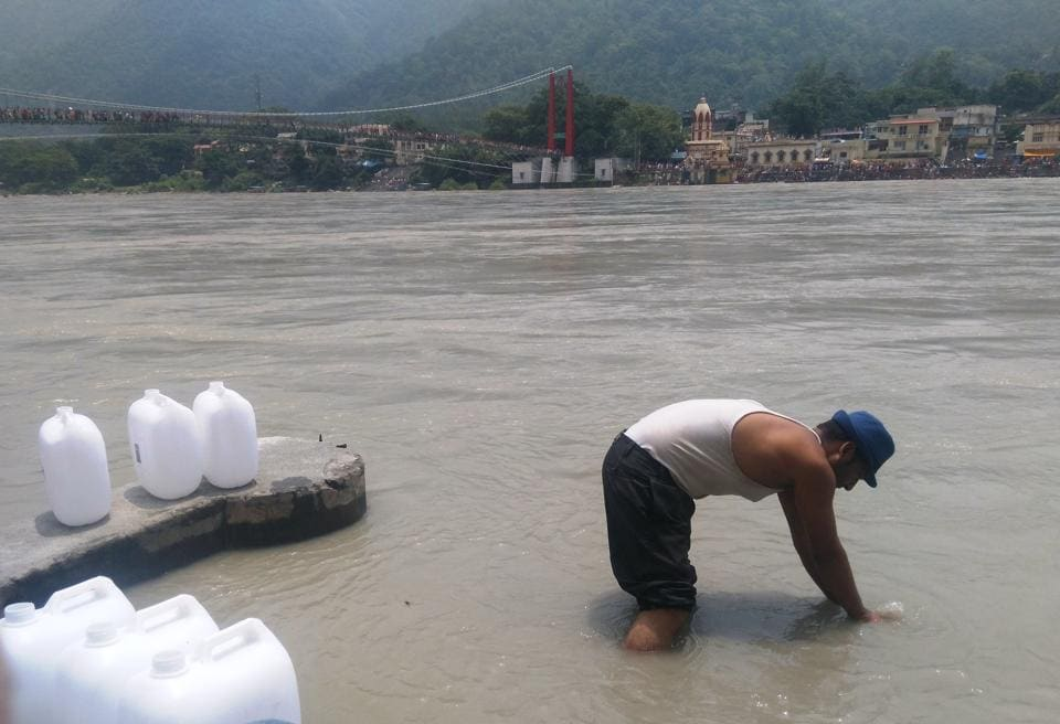 A man fills plastic cans with Ganga water at Rishikesh. NGT had banned use of plastic in and around Rishikesh.