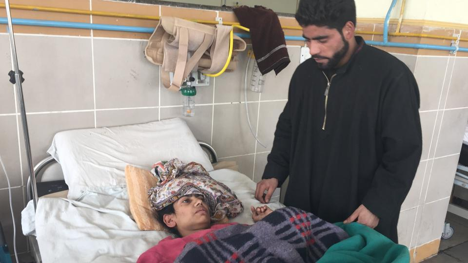 Shameema lies on a bed in the neurosurgery ward of Government Super Speciality Hospital in Shireen Bagh in Srinagar.