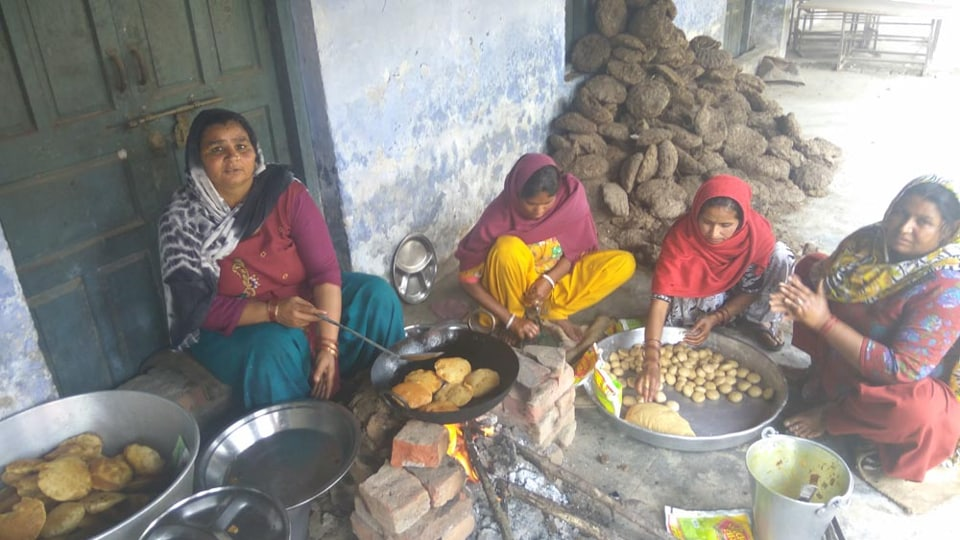 Mid-day meal being cooked with cow dung cakes at government high school in Lakkar village of Chhachroli block of Yamunanagar district.