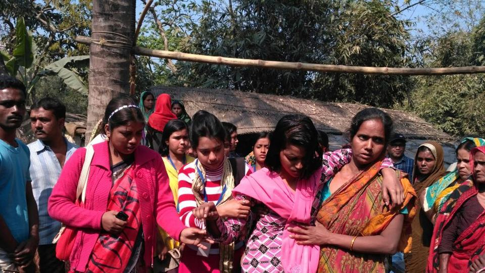 Shamima Sultana (in pink dupatta) being taken to a health centre for treatment.