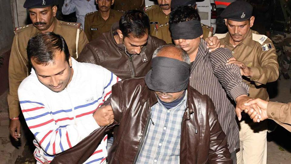 Members of the special investigation team with the arrested accused of BSSC paper leak case, in Patna.