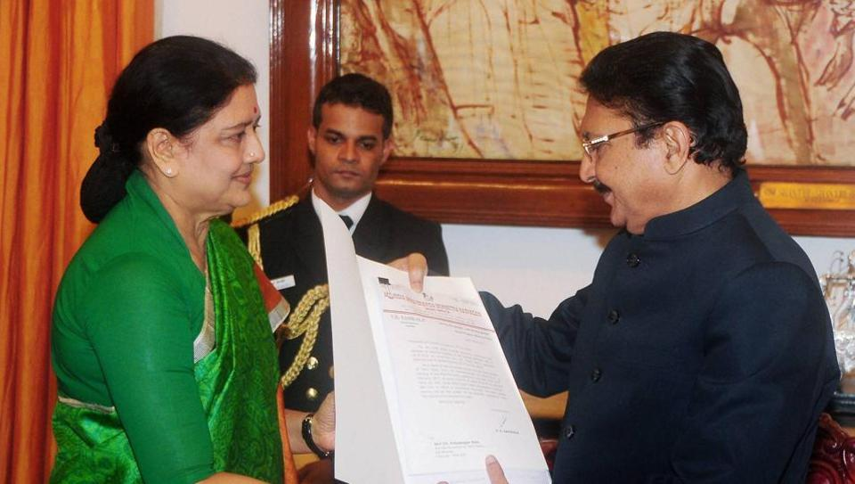 AIADMK general secretary VK Sasikala presenting a list believed to contain the names of MLAs who have endorsed her candidature for the chief minister's post during the meeting with Tamil Nadu Governor Vidyasagar Rao at Raj Bhavan in Chennai on Thursday.
