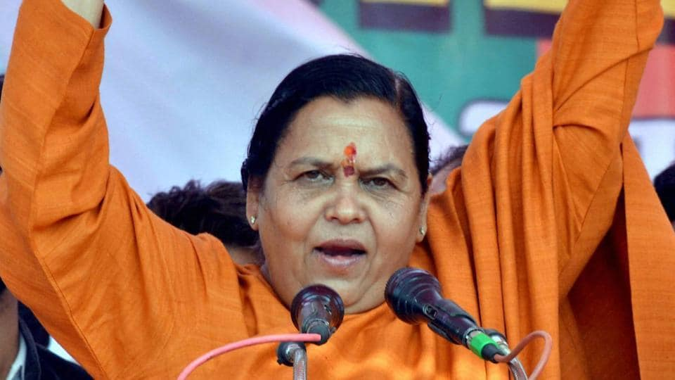 Union minister and BJP leader Uma Bharti addresses an election rally in Agra.