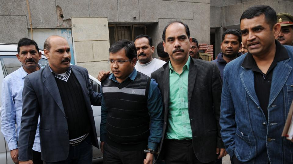 Anubhav Mittal (second from left)  was arrested on February 2. The task force has already recovered ₹524 crore.
