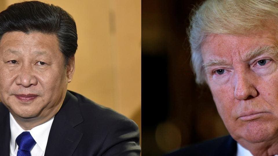 A combination of file photos showing Chinese President Xi Jinping and US President Donald Trump listening to questions from reporters in New York.