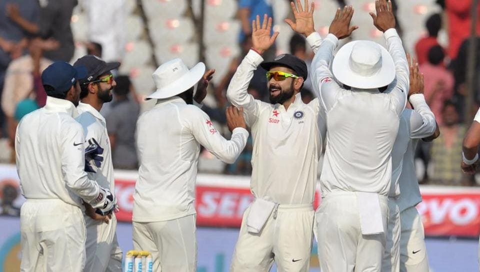 India captain Virat Kohli celebrates with teammates the wicket of Bangladesh's Soumya Sarkar on Day 2 of the Hyderabad Test on Friday. Live streaming and live cricket score of India vs Bangladesh is available online.