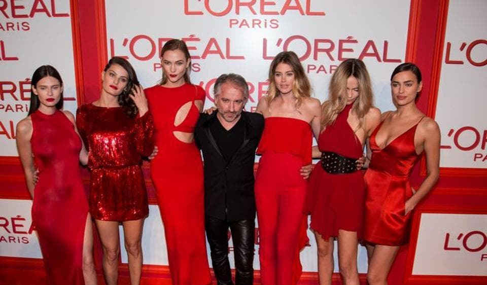 L'Oreal Paris president Cyril Chapuy, center, poses with a bevy of models.